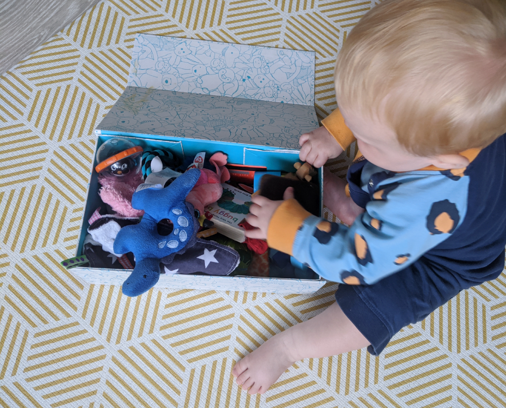 create a sensory box of treasures using household objects for a fun baby play idea
